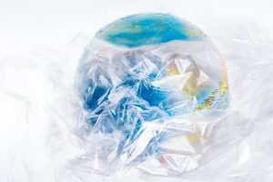 Planet Earth as seen from the sky wrapped in transparent plastic